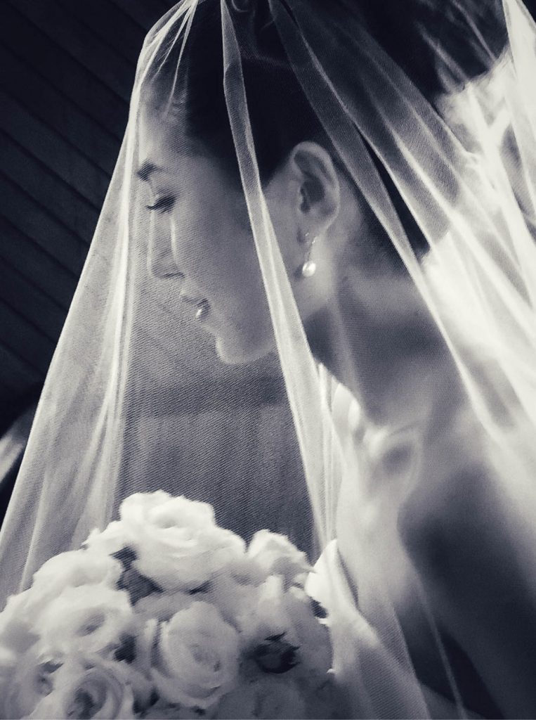 black and white classic portrait of veiled bride