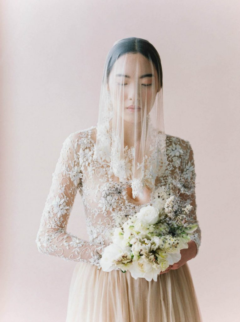 ethereal bride wearing Emily Riggs dress and veil holding petite bouquet by Ponderosa & Thyme