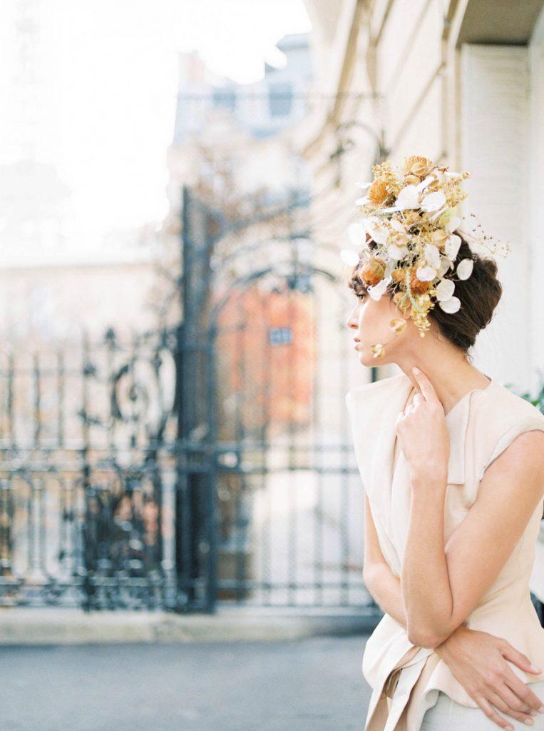 bride wearing avant garde floral headpiece by Floraison Paris