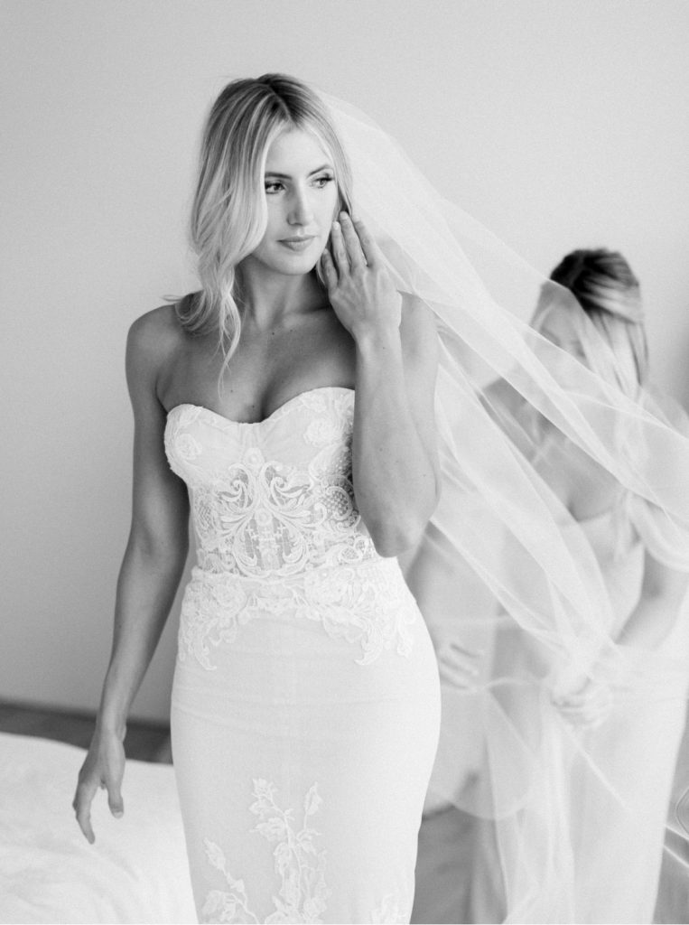 blonde bride wearing Inbal Dror strapless dress and veil in black and white film image