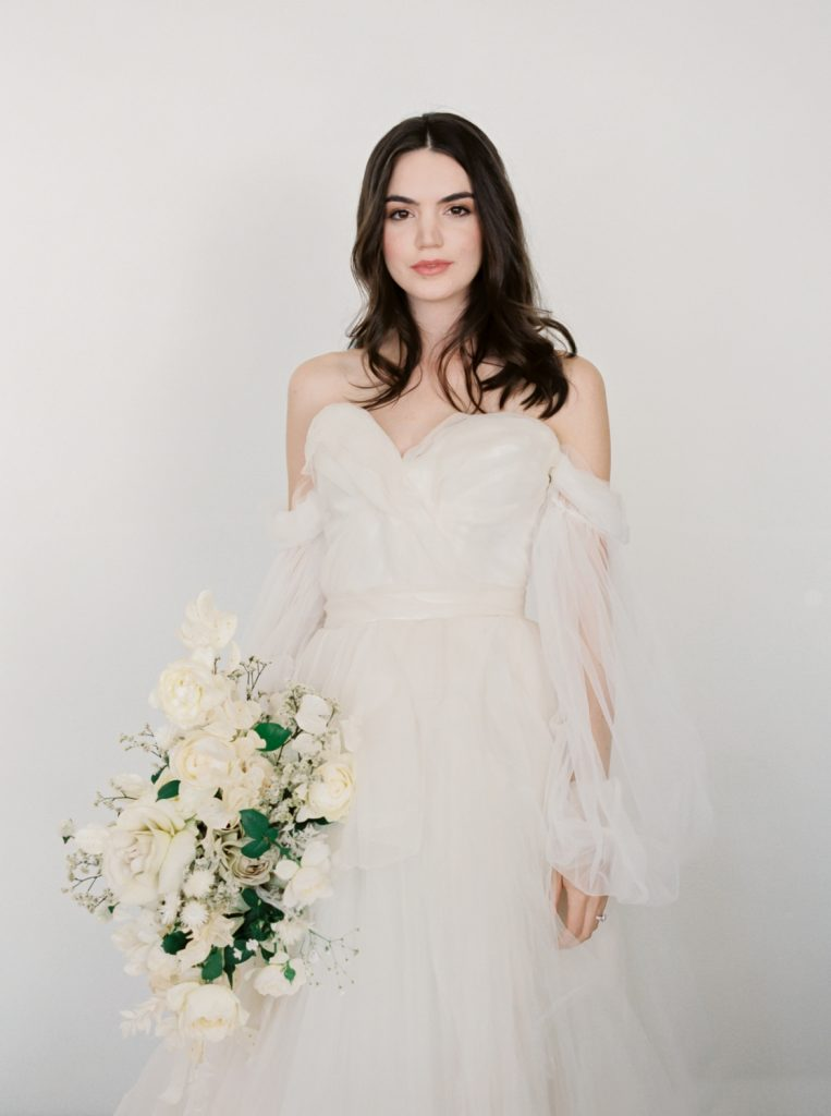 bride styled by Joy Proctor wearing Claire LaFaye dress and holding bouquet by Bows and Arrows Floral