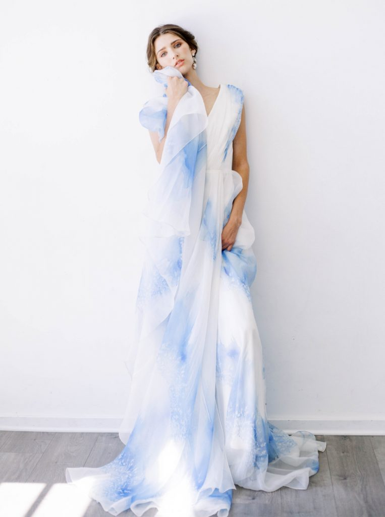 bride wearing Leanne Marshall Dubois gown painted blue and ivory silk organza print that says Je t'aime