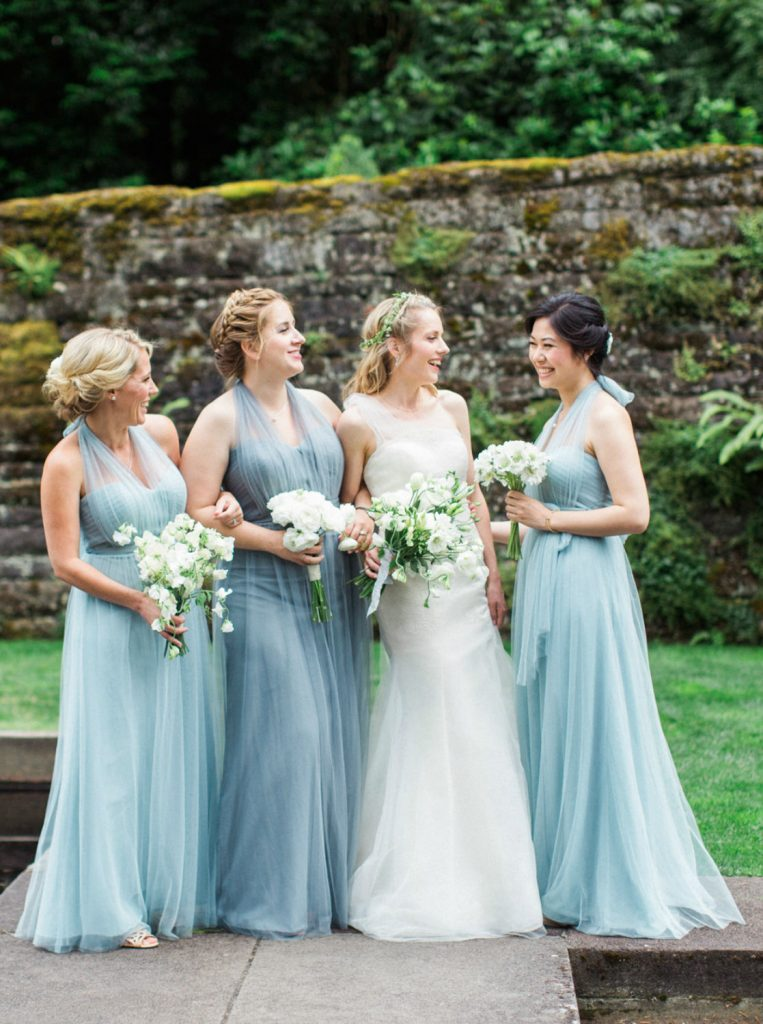 Bride wearing Vera Wang with Jenny Yoo bridesmaids dresses at Lewis and Clark College