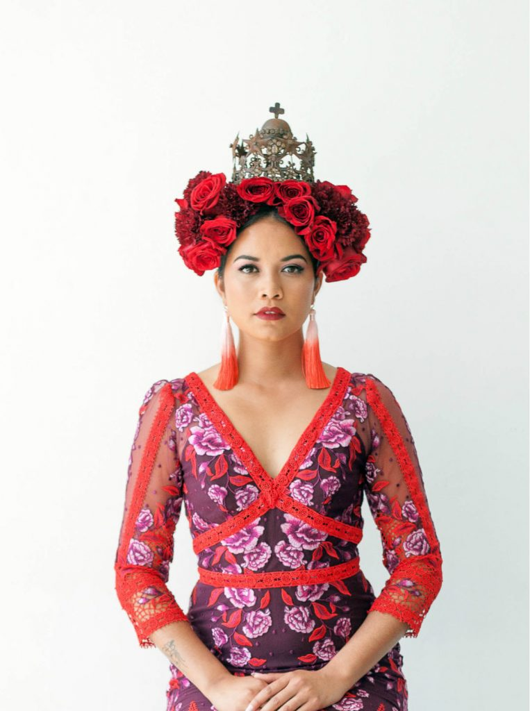 red and purple Met gala meets Frida Kahlo inspired fashion shoot with red roses, rustic crown and Marchesa Notte dress