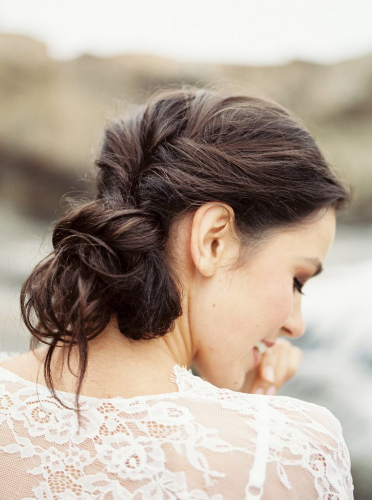 back view of loose twisted messy bun and white lace robe