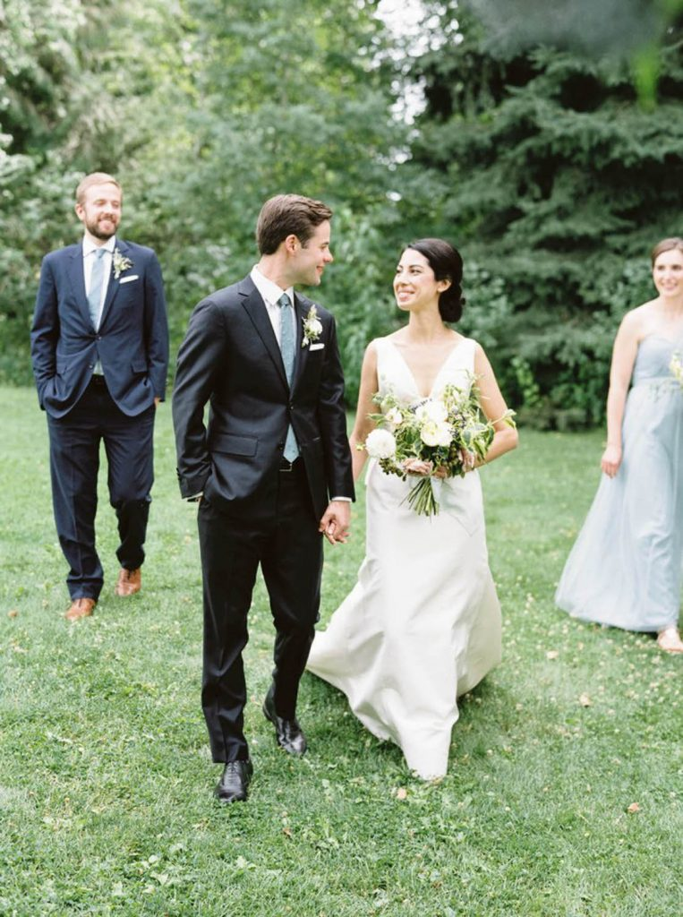 bride and groom stroll at Mt. Hood Organic farms with their best friends