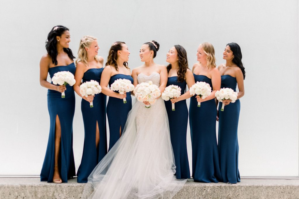 Bride in Monique Lhuillier gown with navy bridesmaids dresses at Portland Art Museum