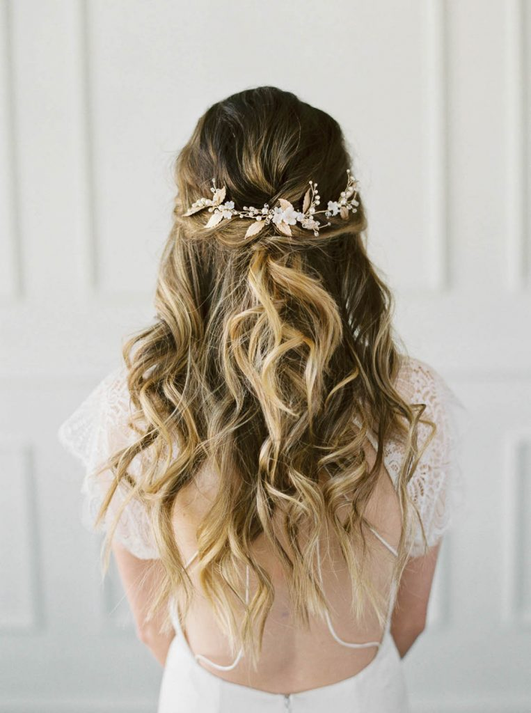 textured half up half down hairstyle with jeweled hair vine