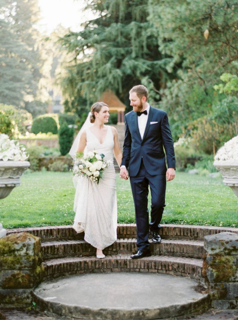 bride and groom walking hand in hand at Lewis and Clark College