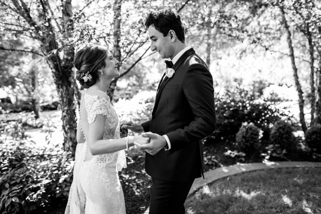 black and white image of couples' first look at The Allison