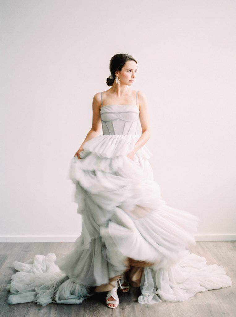 film image of bride swishing layers of silk tulle back and forth