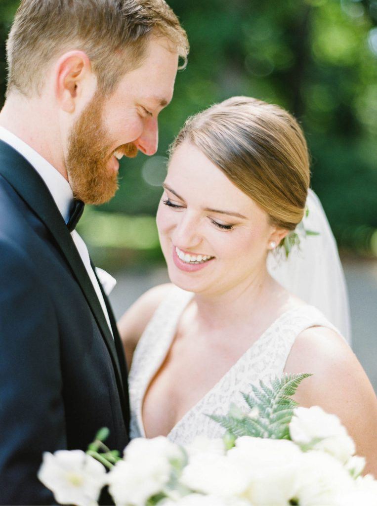 close up portrait of bride and groom smiling shot on Fuji Pro 400H