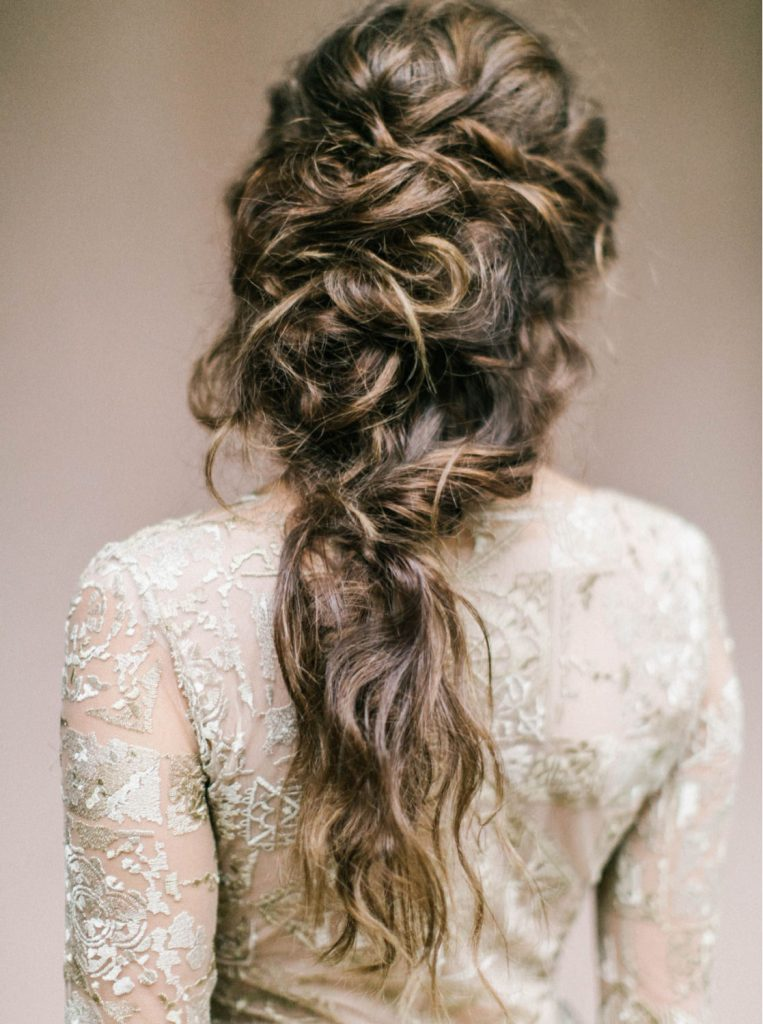 super textured fine art bridal half up hairstyle viewed from the back