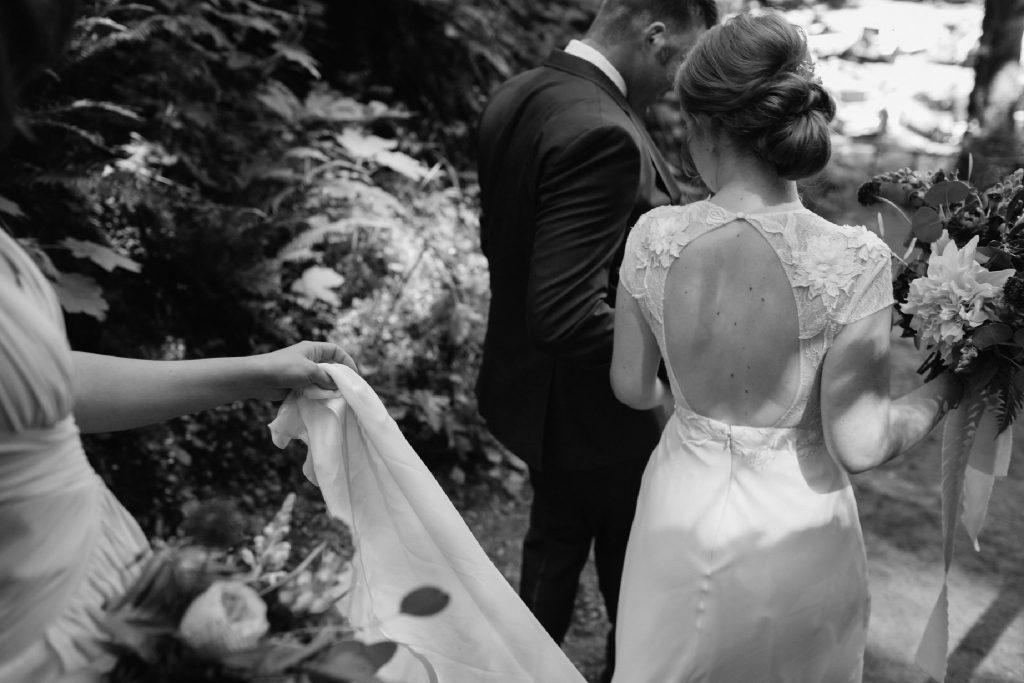 black and white image of bridal chignon and keyhole back dress