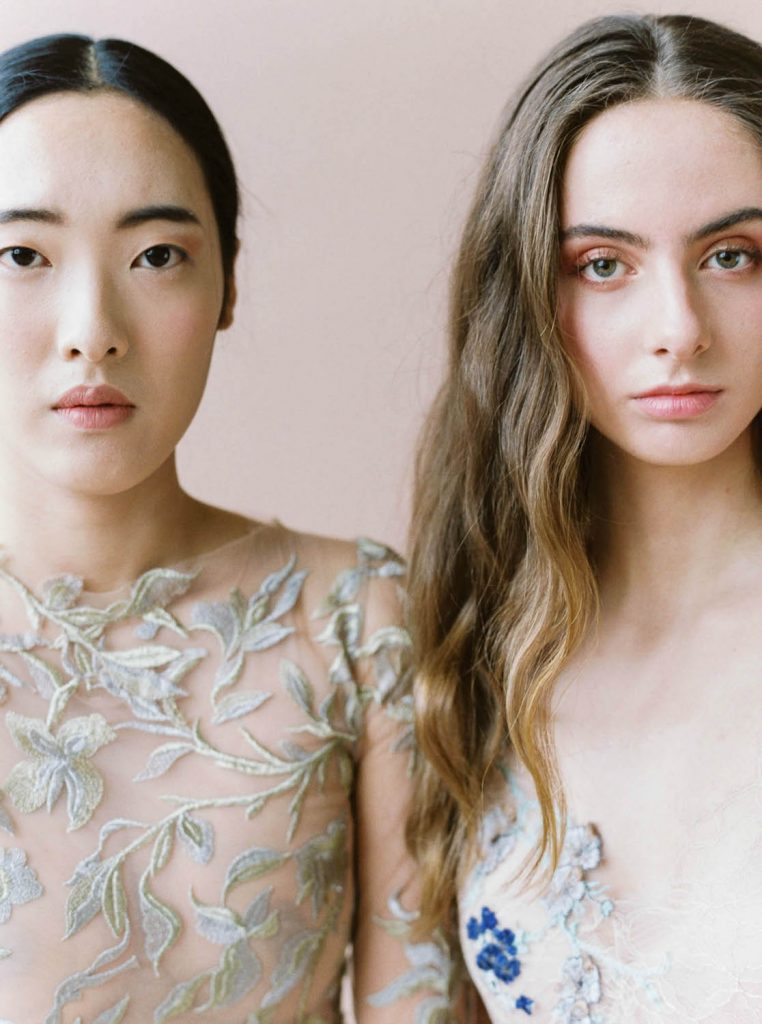 close up two bridal models side by side wearing natural editorial makeup