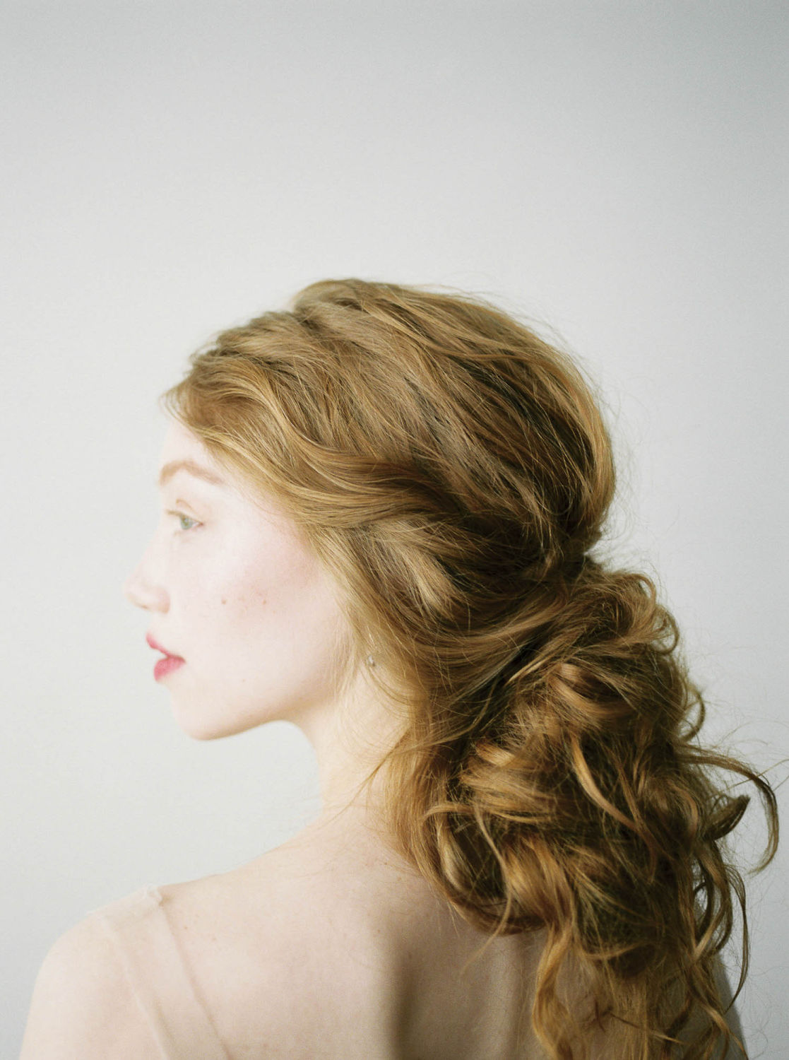 profile of Boticelli-inspired romantic fine art hairstyle and no makeup makeup