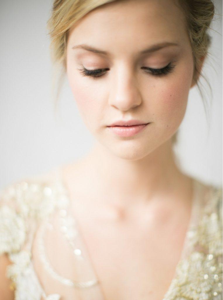 close up bridal portrait with soft subtle pink toned makeup