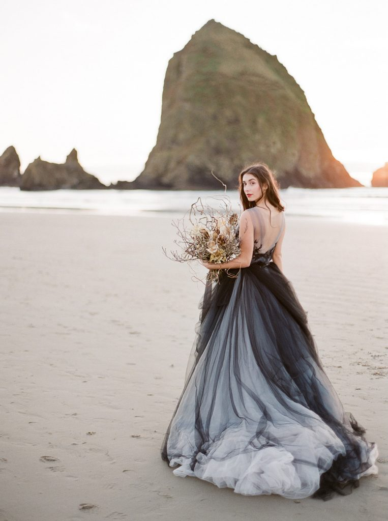 Bride holding dried flower bouquet wearing one of the top fine art dresses of the year, black and gray tulle by MyWony