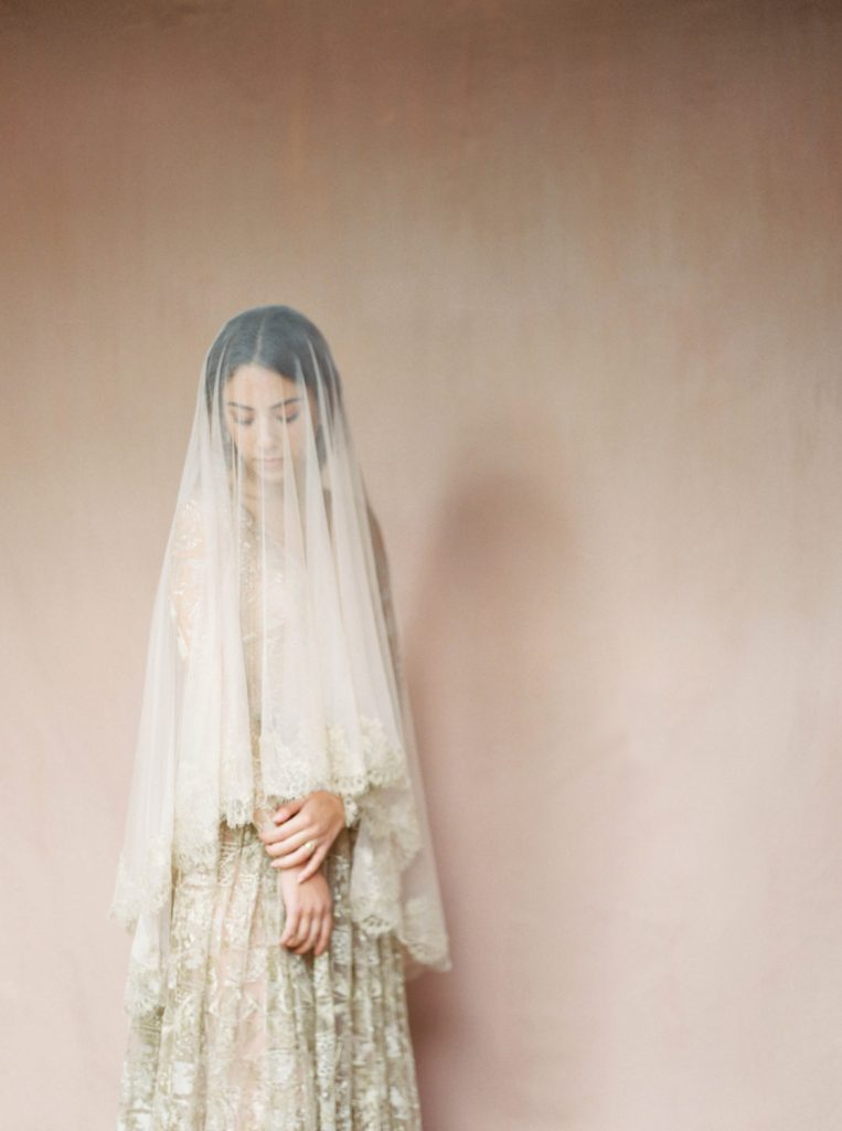 old world Italian style Madonna wedding look with gold veil and dress