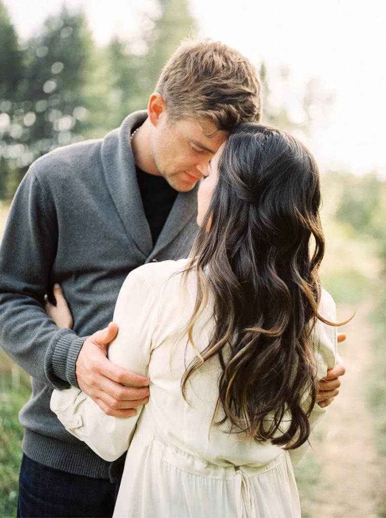man looking at fiancee' with long natural wavy hair