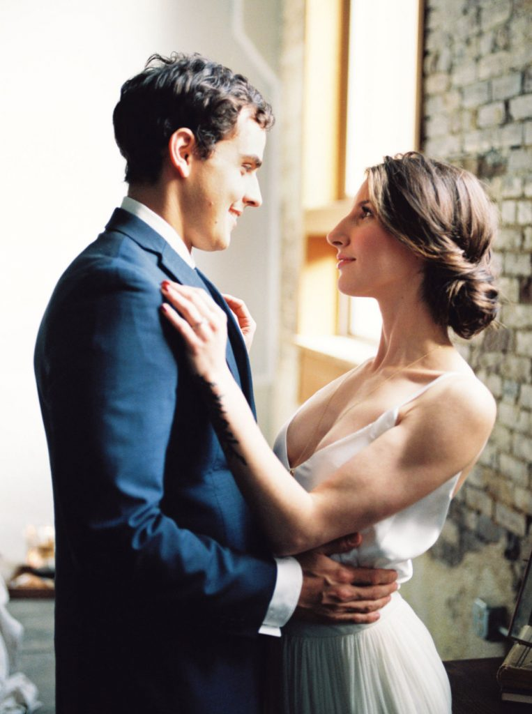 couple holding each other before eloping