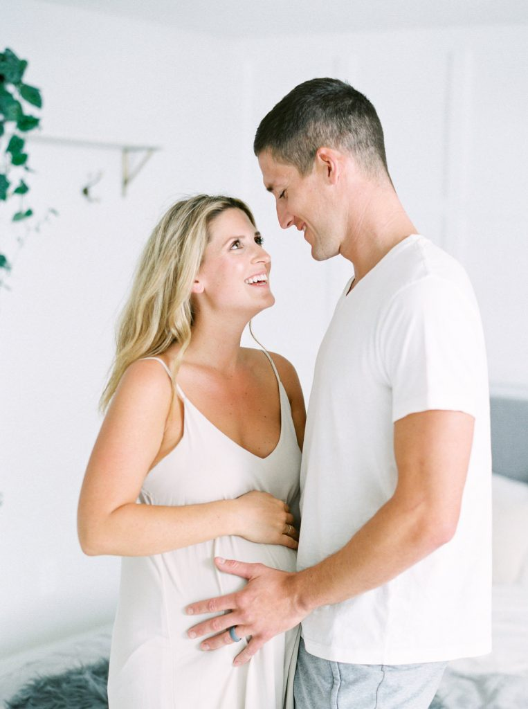 radiant pregnancy glow on woman's face looking at her husband