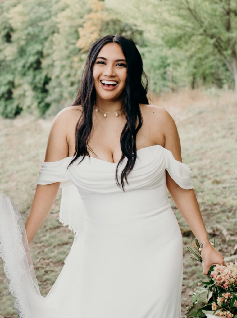 modern bride with lived in hair at winery wedding