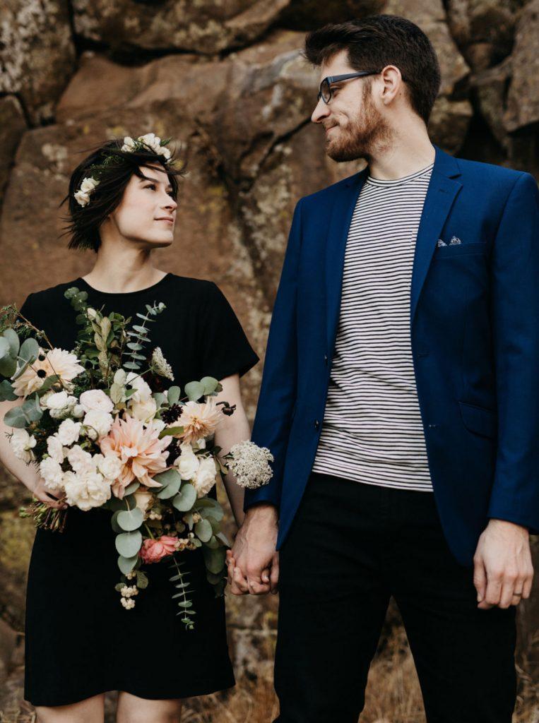 bride elopes wearing short black wedding dress