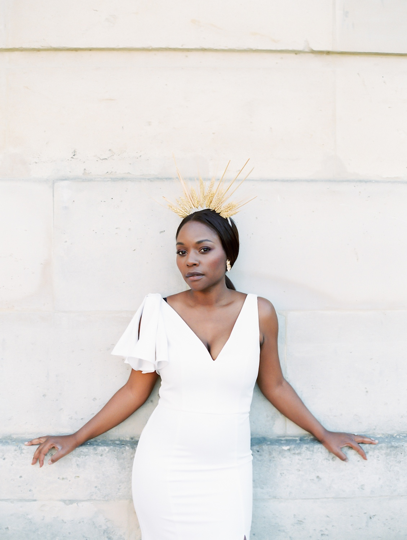 Beautiful Black woman wearing crown made of wheat