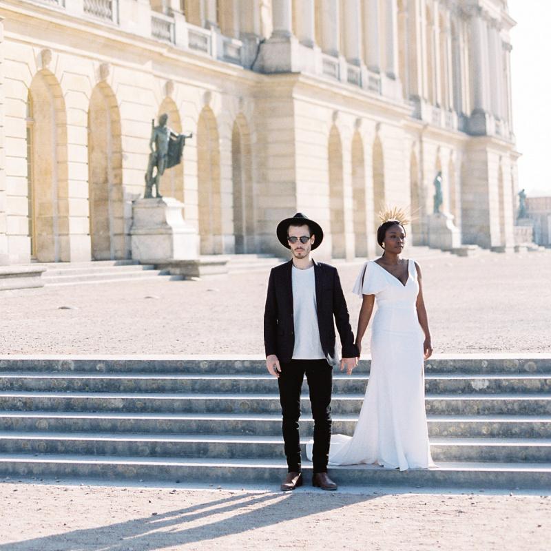 couple poses for photos at Chateau de Versailles